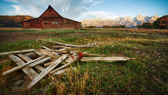 Detritus (Brian Truono Photography) Tags: grandtetons grosventre moose mormon mormonrow moulton nps nationalpark nationalparkservice wyoming autumn barn building clouds door fall frame historic history homestead light mountains nature pioneer ranch ridge roof roofline settlers sky structure sunrise swallow travel wood wooden