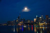 Hanging Low DSN_0281 (iloleo) Tags: night skyline toronto nikond7000 moon reflection longexposure cntower red lights lakeontario waterfront