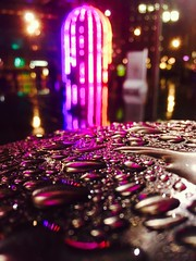 Starman (Explore) (sjpowermac) Tags: birdcage starman identifiedflyingobject bokeh reflection raindrops kingscross stpancras artwork sculpture urban pink purple safety bollard jacquesrival davidbowie psychodelic night