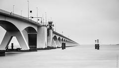 Zeelandbrug (NL) (Henk Verheyen) Tags: brug nl nederland netherlands zeeland zeelandbrug bridge buiten clouds coast kust landscape landschap outdoor sea water wolken zee zierikzee zwartwit blackwhite le long exposure