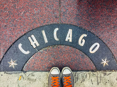 Sweet home... (gabster_ro) Tags: city travel urban chicago building sign stone architecture walking outside outdoors foot construction shoes arch floor outdoor stock structure fromabove sidewalk signage stockphotos overhead stockimages stocksy
