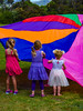 Waving Rainbows (Steve Taylor (Photography)) Tags: parachute ponytail colourful vivid fun happy fabric girl children toddler kid newzealand nz southisland canterbury christchurch newbrighton