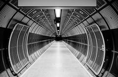 London Underground corridor in black and white (jbarry5) Tags: london londonunderground londonbridgeundergroundstation abstract geometry travelphotography travel monochrome blackandwhite