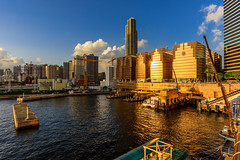 Gold (miltonpics) Tags: asia harbour hongkong kowloon manmade structures tst tsimshatsui ferry boat terminal gold sunset crane construction victoriatowers