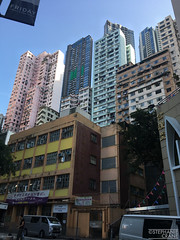 Pastel skyscrapers in Hong Kong. (okaystephanie) Tags: hong kong travel culture china history urban spaces cityscapes ferris wheel skyscrapers street art asia modern chinese architecture nature buddha tian tan statues sky lifts trams signs signage