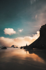 Dreamy (Mikko Lagerstedt) Tags: fine art photography beach night atmospehre blue green water waterscape norway lofoten mood atmosphere person silhouette alone figure detail sand rocks mountains stars starscape mikko lagerstedt photo