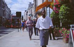 IMG_0719 (ais3n) Tags: city uk light cloud man black streets london canon walking lens photography eos prime restaurant pavement sigma pedestrian sidewalk chef 7d pedestrians fixed dslr length available focal 30mm ais3n