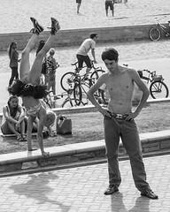 Girl On A Handstand (Jose Matutina) Tags: california street guy girl pier handstand trick orangecounty performer huntingtonbeach sel55210 sonya6000