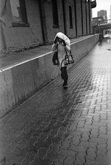 (christait) Tags: street canada calgary downtown grain cover alberta raining yyc ilforddelta3200 yycstreet