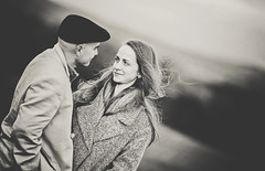 In love (Wojtek Piatek) Tags: ireland blackandwhite dublin woman man love look hat sepia mono engagement eyes couple wind pair sony portriat a99 zeiss135