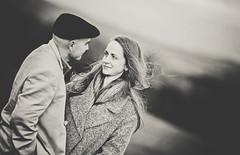 In love (Wojtek Piatek) Tags: ireland blackandwhite dublin woman man love look hat sepia mono engagement eyes couple wind pair sony portriat a99 zeiss135