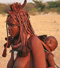 """I'm fine... perhaps."" (vittorio vida) Tags: namibia africa mum mother maternity street tribe himba children boobs bare breast road hair travel"
