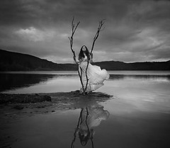 Reflection Of Her Soul (Maren Klemp) Tags: fineartphotography fineartphotographer darkart blackandwhite monochrome water ocean nature outdoors selfportrait surreal reflection conceptual evocative ethereal tree sky clouds etheral dreamy painterly movement dream portrait woman
