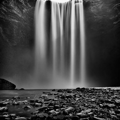Earth's Hair (FerTravelPhoto) Tags: autumn bw black blackandwhite commons d750 fall grain iceland landscape longexposure monochrome naturaleza nature nikon outdoor peaceful river rocks skogafoss tamron travel water waterfall white winter