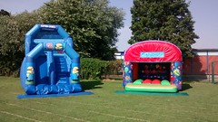 8ft platform slide (left) available with different themes, suitable up to 10 year olds £80 per hire. 13x13 Celebration themed bouncy castle (right) only £55 per hire.
