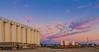 Look to the East (johnwilliamson4) Tags: adelaide blue clouds cranes orangs pink portadelaideriver silos southaustralia trailers tanks portadelaide australia au