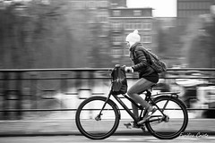 Panning 7 (cristoeuridice) Tags: street winter motion cold travelling amsterdam speed grey blackwhite movement travels streetphotography bikes monocromatic panning viagens bycicle fotografiaderua