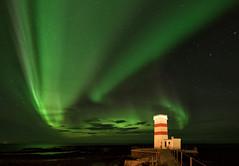 The Green Lights of Gardur Lighthouse (Kristin Repsher) Tags: longexposure autumn sky lighthouse night iceland nikon aurora d750 northernlights auroraborealis gardur reykjanespeninsula