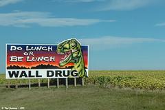 Must be in South Dakota... (Thad Zajdowicz) Tags: leica travel sky color field sign southdakota words highway dinosaur outdoor text letters humor billboard type walldrug zajdowicz