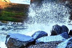 Whoosh. (Les Fisher) Tags: rocks waves spray seashore sheringham northnorfolk northnorfolkcoast sheringhambeach