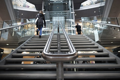 Library Vanishing Point [34/365 2017] (steven.kemp) Tags: library stairs glass quiet people norwich handrail symmetry low pov millenium forum