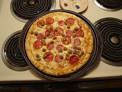 Pizza For Supper. (dccradio) Tags: marshfield wi wisconsin centralwisconsin woodcounty halloween stove burners pizza circle round meatpizza crust meltedcheese pepperoni sausage ham canadianbacon pizzapan