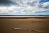 drifting (Keith Midson) Tags: beach burnie boat ship ocean bassstrait sand driftwood clouds tasmania