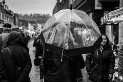 Birdcage (Silver Machine) Tags: winchester hampshire streetphotography street candid umbrella woman birdcageumbrella blonde walking people outdoor rain fujifilm fujifilmxt10 fujinonxf35mmf2rwr blackwhite bw mono monochrome