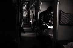 The Passenger (thirdworldsong) Tags: india agra blackandwhite bw black white shadow contrast exposure grey light lighting dark darkness train passenger aisle travel varanasi people person asia thinking thought emotion ceiling moody character seat bunk overhead time ride land aroundtheworld photography photographer blogger portfolio work dreams visual detail picture paint composition look see feel man stranger life geometry feeling deep