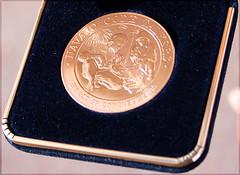 ncodetalkersm01 (jaarockin) Tags: blue southwest macro yellow gold 2000 medal nativeamerican navajo veterans bilingual codetalkers medalian