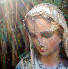 Needing no words..... (cattycamehome) Tags: light woman sun face statue tag3 religious rainbow tag2 all tag1 message decay quality madonna faith mary  mother icon holy virgin rights damage damaged sunrays reserved catherineingram june2006 cattycamehome allrightsreserved