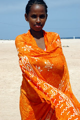 on the beach (united*colours) Tags: africa orange black verde beach girl beautiful cabo baia fivestarsgallery