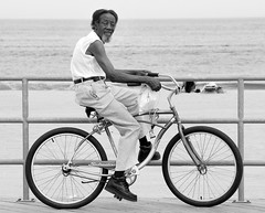 Bicycle Rider On The Boardwalk - B&W (Bob Jagendorf) Tags: bw beach bike bicycle nj asbury 123njpeople jagendorf