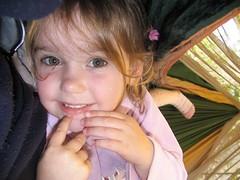 My niece and Hammock (Cyclingrelf) Tags: pink cute girl smile fun child play sweet cheeky greeneyes niece hammock scored score30