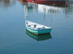 Boat adrift in the mind's river (Bluepeony) Tags: ocean blue red sea summer white reflection water reflections harbor boat poem harbour august rowboat skiff rockport drift punt capeann theworldthroughmyeyes