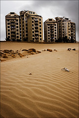 Castles on the Sand (Edge of Space) Tags: buildings interestingness interesting apartments cityscape human ugly karachi dwellings exhibition14august pakscape castleonsand