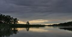 Rauhallinen ilta I (villoks) Tags: sea reflection tag3 taggedout finland evening tag2 tag1 july 2006 meri kes darksky kustavi heinkuu canonef28135mmf3556isusm tummataivas