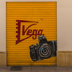 Vega (gorrhyza) Tags: door camera wall spain fuji andalucia fujifilm malaga x100s