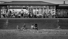 On the sea shore (fishyfish_arcade) Tags: people blackandwhite bw beach monochrome coast blackwhite seaside cafe sand nikon strangers lincolnshire promenade seafront mablethorpe nikond3200 55200mm d3200