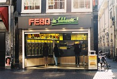 (Tori Taylor) Tags: street camera city food sun colour film amsterdam bike bicycle sign shop 35mm canon out poster graffiti focus europe european pigeon go citylife culture fast bikes 200iso led iso 200 take manual graffit cultural buying febo t50 amterdam1