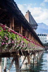 Kapellbrcke Flowers (LukeStonesPhotos) Tags: bridge flowers roses tower water buildings river switzerland luzern lucerne lakeluzern lakelucerne kapellbrcke reuss riverreuss