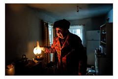 A Light in the Darkness (Roman Lunin) Tags: ukraine easternukraine man kerosenelamp kerosene crisis humanitariancrisis aid people peopleathome war warinukraine warukraine donbass old elderly povert poverty age aged agedpeople village report reportage journalism photojournalism postussr warwithrussia russia