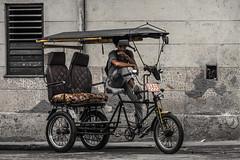 Waiting, wondering, watching (janet.capling) Tags: cuba havana driver waiting wondering watching cigarette bike carriage taxi cushion comfort yellow cliche