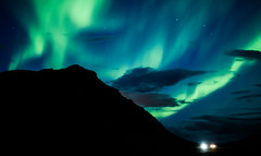 Scattered lights (danielfj91) Tags: iceland nature aurora borealis auroraborealis sky night le long exposure stars silhouette akranes akrafjall landscape beam green blue black traffic wow