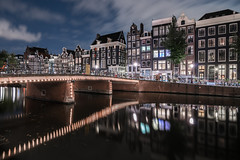 Diversions (McQuaide Photography) Tags: amsterdam noordholland northholland netherlands nederland holland dutch europe sony a7rii ilce7rm2 alpha mirrorless 1635mm sonyzeiss zeiss variotessar fullframe mcquaidephotography adobe photoshop lightroom tripod manfrotto light licht night nacht nightphotography longexposure stad city capitalcity urban lowlight architecture outdoor outside old oud gracht grachtenpand canalhouse house huis huizen traditional authentic water reflection centrum gebouw building waterfront waterside canal colour colours color wideangle groothoek wideanglelens singel windows bridge brug illuminated