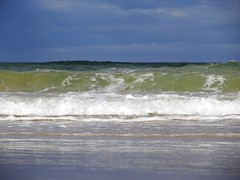 115. Surfing Waves (GraynKirst) Tags: blue sea sky cloud beach water clouds coast scotland seaside surf waves aberdeenshire wave shore northsea swells seagreen stcombs grahamjarman