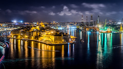 Cospicua - Malta - Travel photography (Giuseppe Milo (www.pixael.com)) Tags: city longexposure travel sea sky urban seascape motion water night clouds landscape geotagged photography lights photo europe long exposure mt sony malta full frame 24 fe fullframe onsale 70 a7 valletta cospicua sony2470 ilbeltvalletta sonya7 sonyfe2470