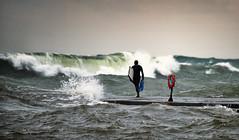 surfing the Great Lakes (paulh192) Tags: autumn storm water sport danger pier nikon michigan sigma wave surfing lakemichigan greatlakes approved grandhaven crashingwaves dangeroussport hugewave