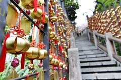 "Wind chimes along the ""Stairways to Heaven"" (Melvin Yue) Tags: city travel red lake colors stairs canon temple photography photo cityscape wind bokeh chinese taiwan charm luck lucky ribbon taipei yuchi chimes sunmoon sunmoonlake luckycharm travelphotography wenwu 60d"