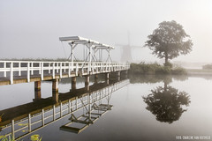 Thick Fog, Kinderdijk (Charlene van Koesveld) Tags: fog kinderdijk foggy mist bridge tree mill windmill windmills holland dutch tourism travel netherlands nederland zuidholland southholland reflection water morning city landscape dense outdoor white pure haze